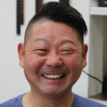 40男性笑顔の画像